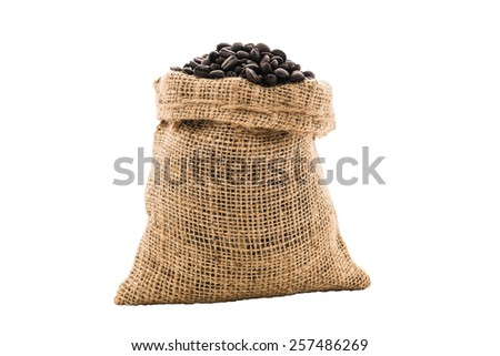 Coffee beans in burlap bag on white background - stock photo