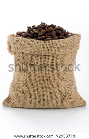 Coffee beans in burlap sack - stock photo
