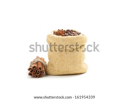 Coffee beans in burlap sack, isolated on white