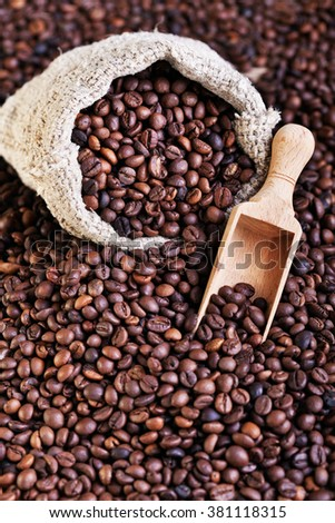 Coffee beans - in burlap with scoop - stock photo