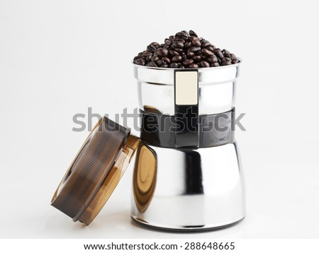 Coffee beans in coffe grinder - stock photo