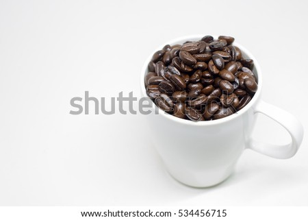 Coffee beans in cup.
