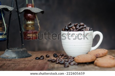 Coffee Beans In Cup and Chocolate Cookies  - stock photo