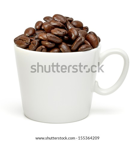 Coffee beans in cup with clipping path - stock photo