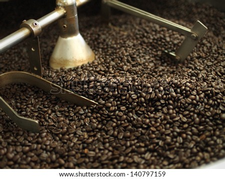 coffee beans in roast machine - stock photo