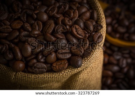 Coffee Beans in Sack Background - stock photo