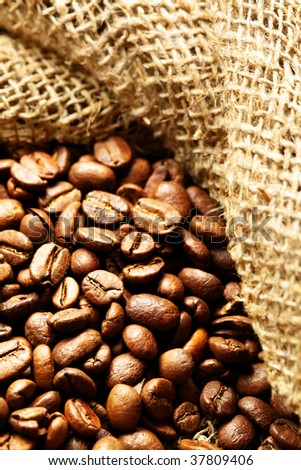 Coffee beans in sack close up - stock photo