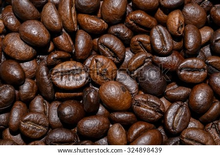 Coffee beans in the background. Coffee beans. Coffee beans. Coffee beans. Coffee beans. Coffee beans. Coffee beans. Coffee beans. Coffee beans. Coffee beans. Coffee beans. Coffee beans. Coffee beans.  - stock photo
