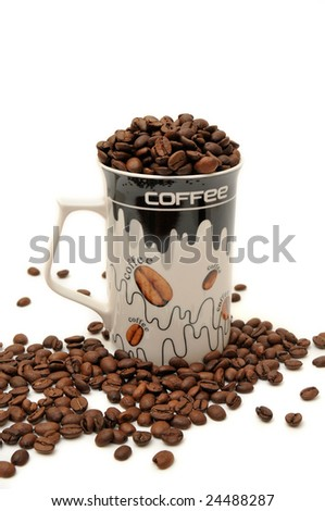 Coffee beans in the glass on white background - stock photo