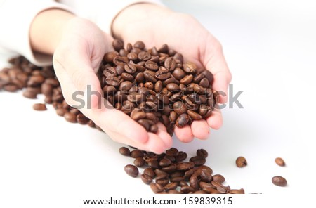 coffee beans in the hands of a child - stock photo