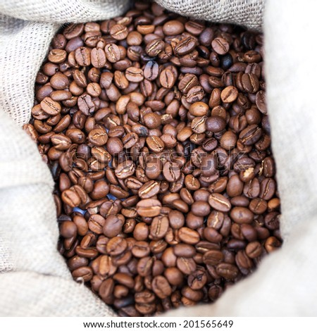 Coffee beans in the sack close up - stock photo