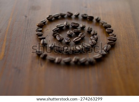 Coffee beans in the shape of seashells (Shallow DOF). - stock photo