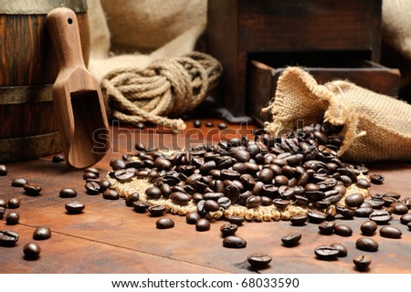 Coffee beans in vintage setting - stock photo