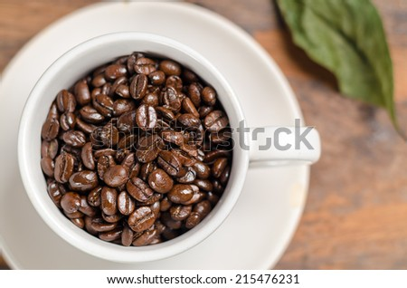 Coffee beans in white coffee cup