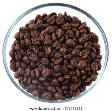 Coffee beans inside glass jug on white background - stock photo