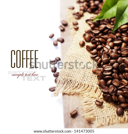 coffee beans isolated on white background (with sample text) - stock photo