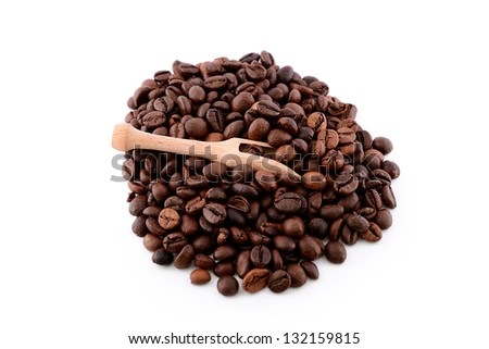Coffee beans isolated on white background with spoon - stock photo