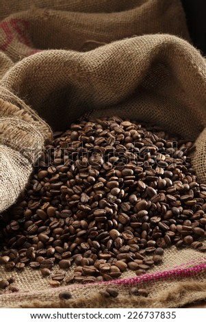 coffee beans/jute canvas with coffee beans - stock photo
