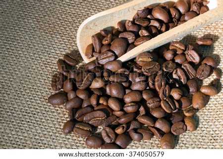 Coffee beans lying on jute fabric / Coffee beans - stock photo