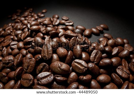 Coffee beans on a black studio background. Selective focus. - stock photo