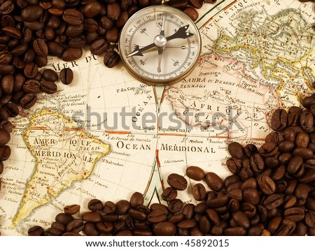 Coffee beans on a map from XVIII century. - stock photo