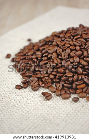 coffee beans on a wooden background. copy space