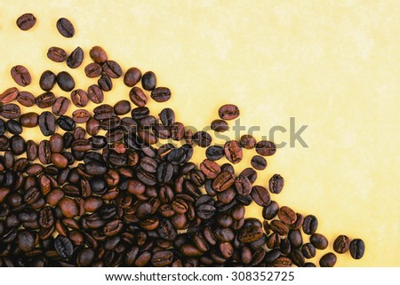 Coffee beans on a yellow background - stock photo