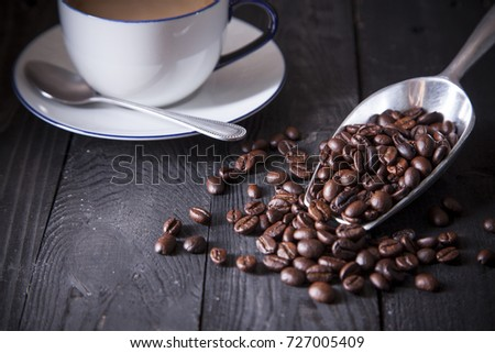 Coffee beans on black wood table