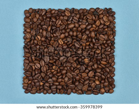 Coffee beans on blue paper, vintage carton. Studio macro image. Can be used as a poster or background in design. - stock photo