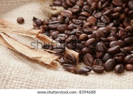 Coffee beans on burlap fabric - stock photo