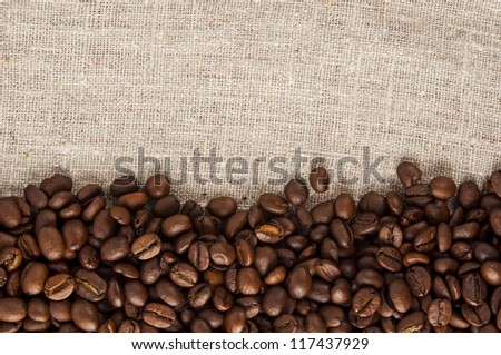 coffee beans on canvas - stock photo