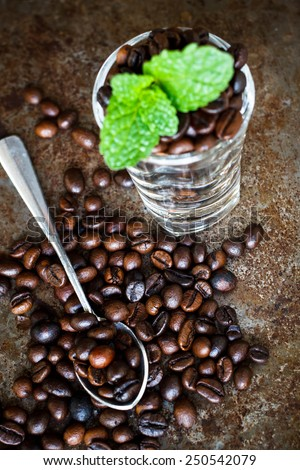 Coffee beans on glass metal background - stock photo