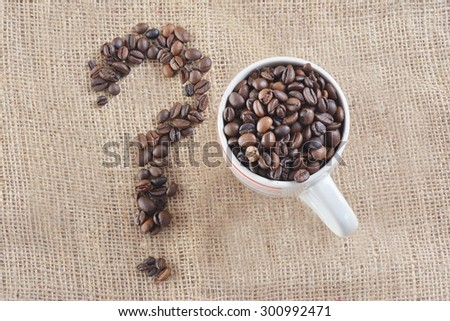 Coffee Beans on gunny, available light - stock photo