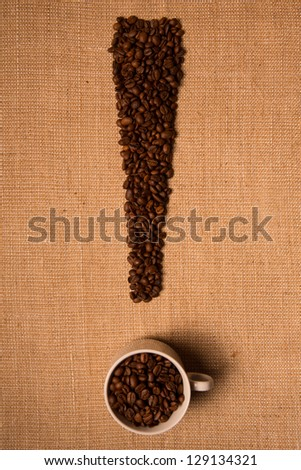 Coffee beans on linen background (exclamation) - stock photo