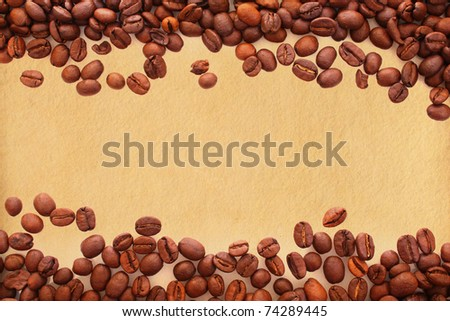 Coffee beans on old paper background - stock photo
