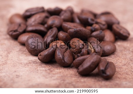 Coffee beans on old vintage surface background. Shallow DOF. - stock photo