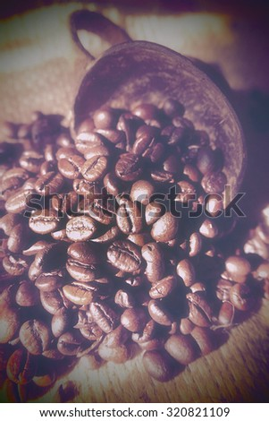 Coffee Beans on Sack Background with Vintage Style and Filtered Image.