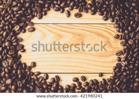 Coffee beans on the table.Free space for your text. Coffee wood. - stock photo