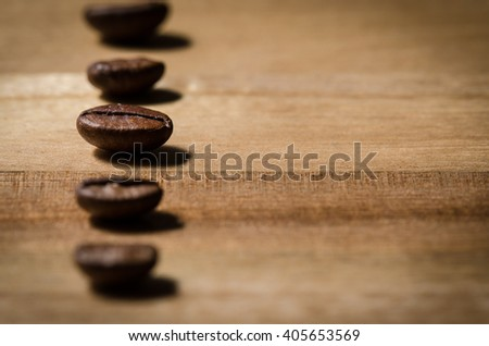 Coffee beans on wood  - stock photo