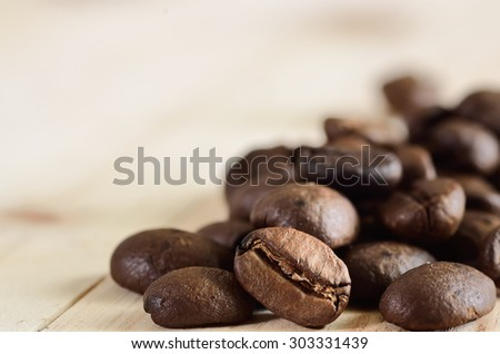 Coffee beans on wooden - stock photo
