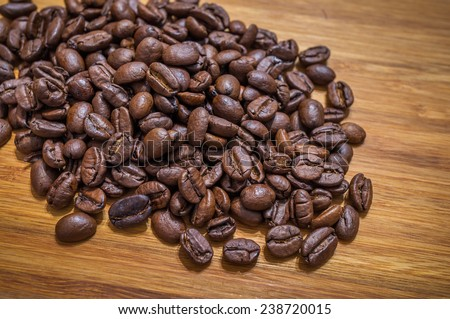 Coffee beans on wooden background - stock photo