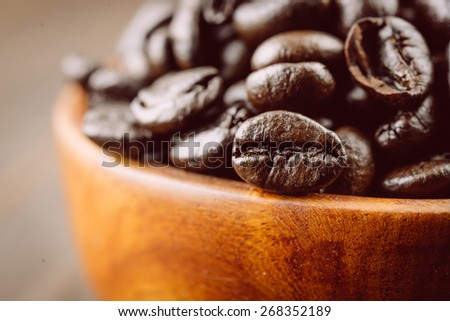 Coffee beans on wooden background - vintage effect style pictures