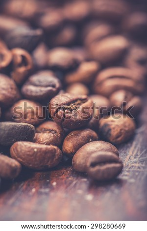 Coffee beans on wooden background, Vintage food photo - stock photo