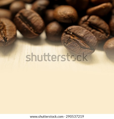 coffee beans on wooden table for background