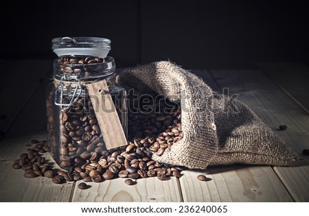 Coffee beans out a sack and jar  - stock photo