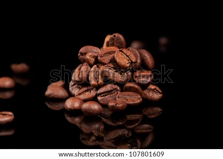 Coffee beans pile isolated on black background. Culinary coffee background. - stock photo