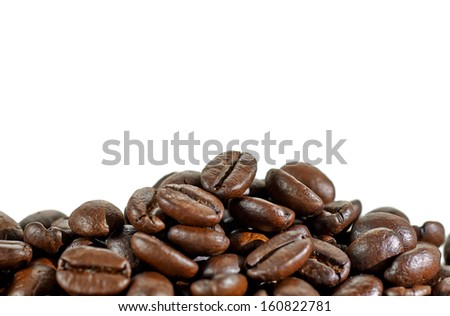 Coffee beans pile with shallow depth of field - stock photo