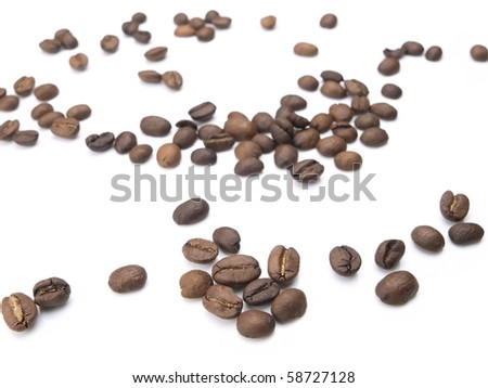 Coffee beans scattered, isolated on white. - stock photo
