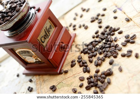 Coffee beans scattered upon the old map
