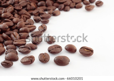 Coffee beans scattered with copy space. No sharpening